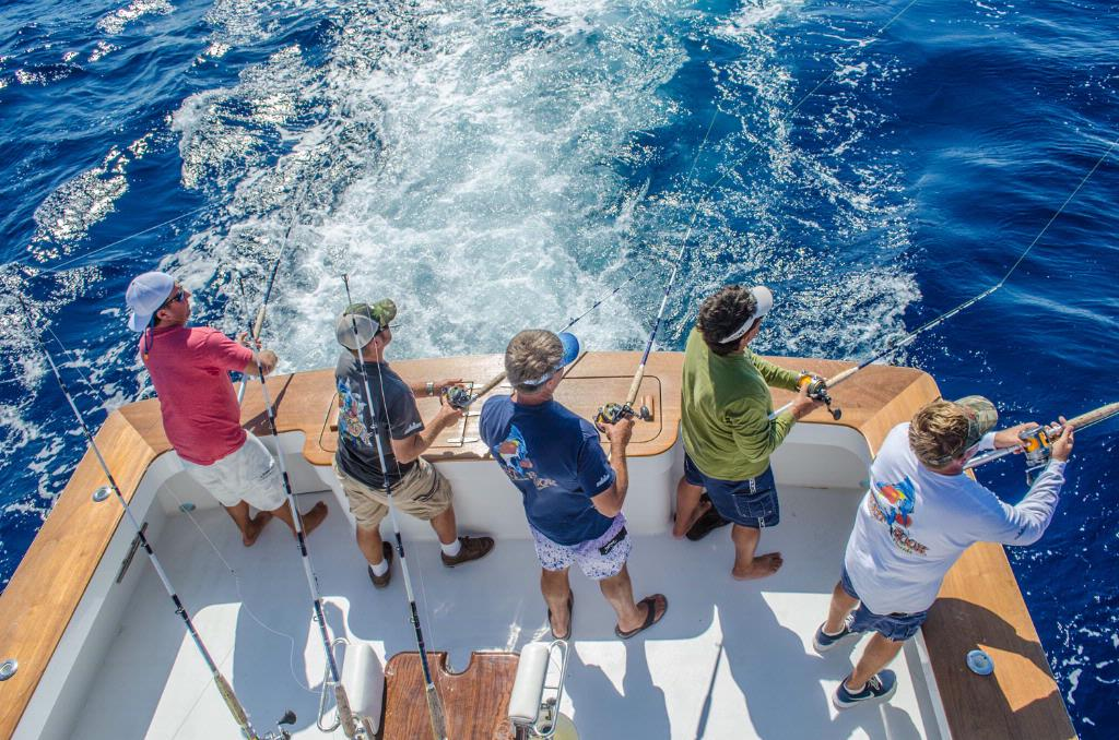Group of guys sea fishing off a boat.