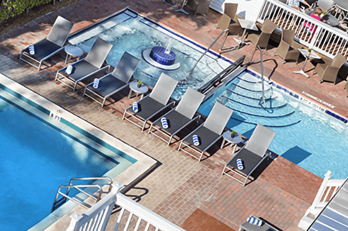 Bird's eye view of pools, hot tub and beach chairs.