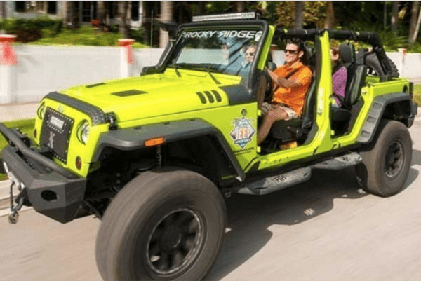 Couple in yellow-green jeep.